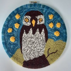 Punch needle owl surrounded with yellow pop out puffs / stars