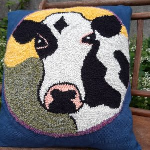 Cushion Bo is a cushion with a cow's pattern