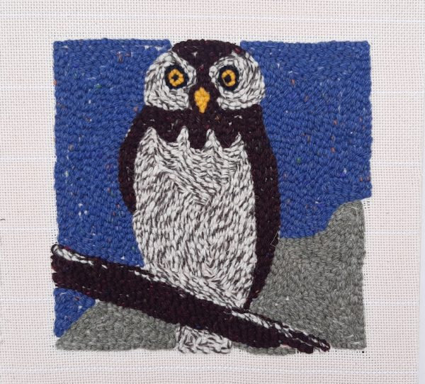 Back side of punch needle pattern showing night owl