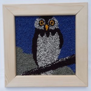 Framed punch needle pattern showing night owl
