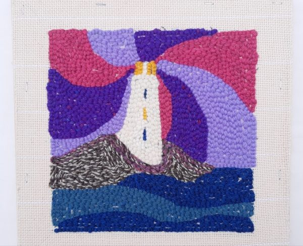Back side of punch needle pattern showing rose lighthouse