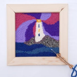Punch needle pattern showing a rose lighthouse